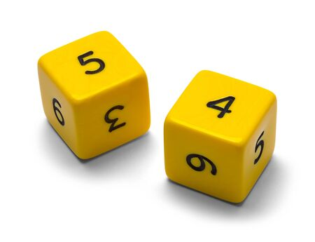 Two Yellow Numbered  Dice Isolated on a White Background.