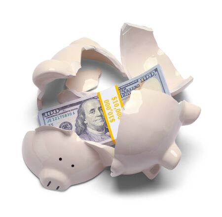 Broken Piggy Bank with a Stack of Money Isolated on a White Background.