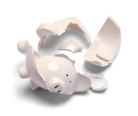 Broken Piggy Bank Isolated on a White Background. Reklamní fotografie