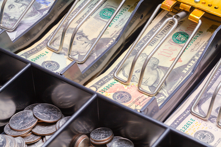 Open Cash Register Drawer Close up with Money.