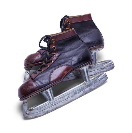 Pair of Old Worn Ice Skates Isolated on White Background. Stock Photo
