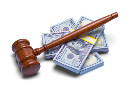 Judges Gavel with Stack of Money Isolated on a White Background.