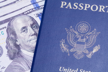 USA Passport with Cash Money Isolated on a White Background.