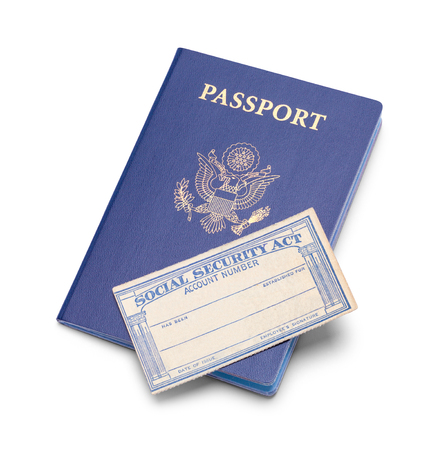 United States Passport with Social Security Card Isolated on White Background.