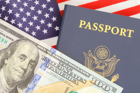 American Passport Close Up With Money on Top of USA Flag. Stock fotó