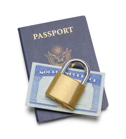 Passport with Social Security Card and Lock Isolated on White.