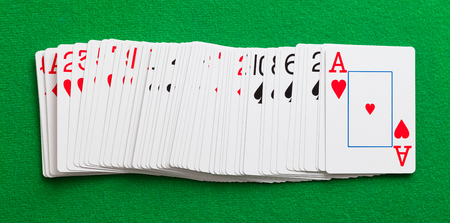 Deck of Playing Cards Spread Out on Table.