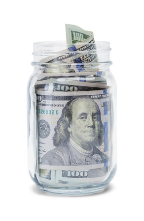 Glass Jar Filled with Cash Isolated on White.