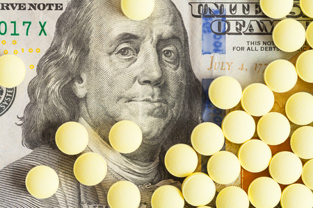 Hundred Dollar Bill With Yellow Medicine Pills.
