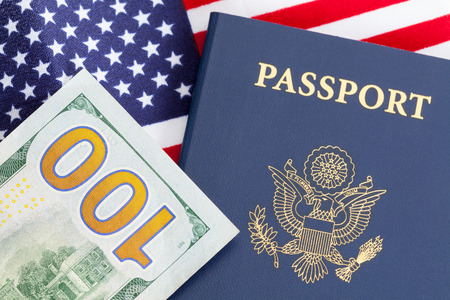 Blue United States Passport and American Flag with Money.