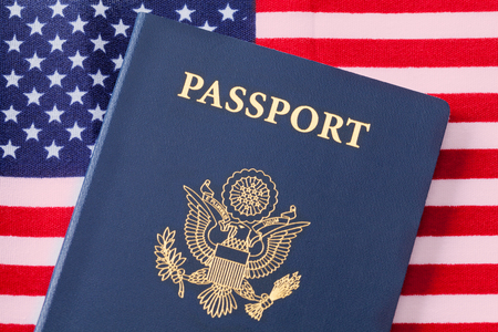 Blue United States Passport and American Flag.