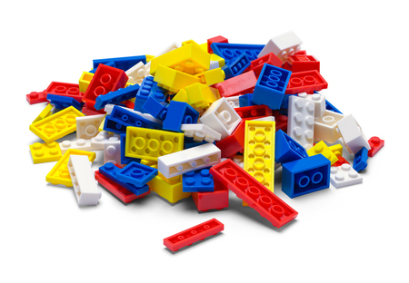 Small Pile of Plastic Toy Blocks Isolated on White.