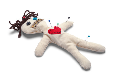 Voodoo Doll with Needles Isolated on White Background. 版權商用圖片