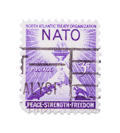Old Nato Postage Stamp Isolated on White Background.