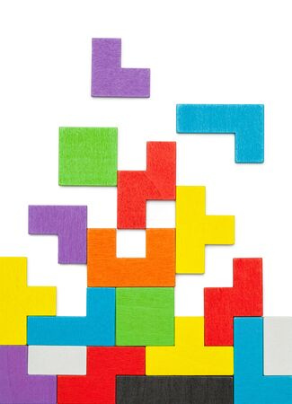 Colorful Geometric Shape Wood Puzzle Blocks Isolated on White.