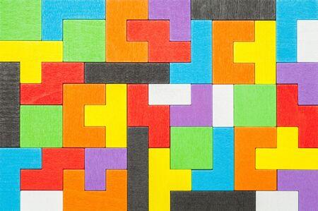 Colorful Geometric Shape Wood Puzzle Blocks Background. Stock Photo