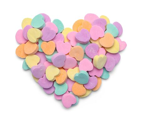 Pile of Valentine Candy Hearts in Heart Shape Isolated on White.