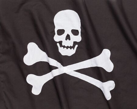 Waving Cross Bones Pirate Flag with Ripples Background. Archivio Fotografico