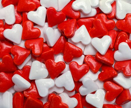 Red and White Valentines Candy Hearts Background.