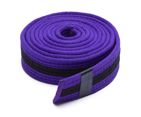 Purple Rolled Karate Belt Isolated on White.