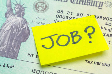 Federal Tax Refund Check with Sticky Note Saying Job Stok Fotoğraf