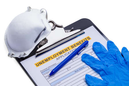 Unemployment Benefits Application on Clipboard with N95 Mask and Gloves. Stok Fotoğraf