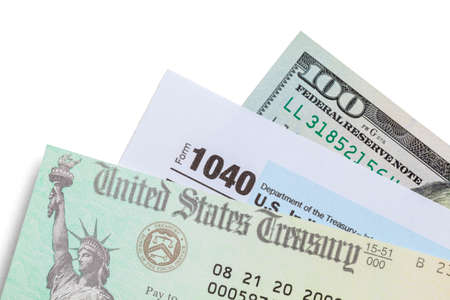 Tax Refund Check with Form 1040 and One Hundred Dollar Bill.