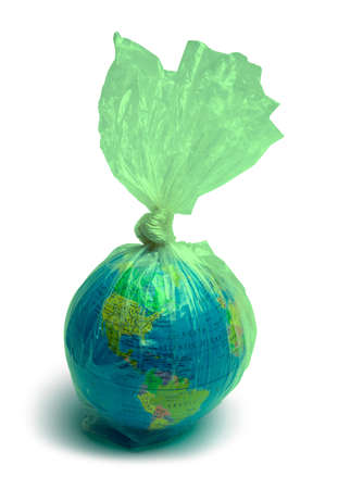 Planet Earth in Green Trash Bag Cut Out on White. Stok Fotoğraf