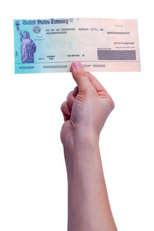 Womans Hand Holding Up a Tax Refund Check.