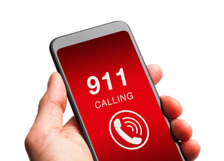 Hand holding smartphone with 911 call.