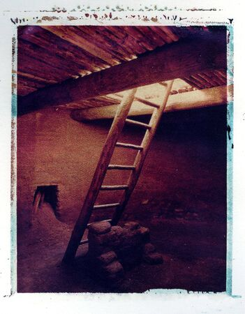 kiva: Kiva with ladder, Pecos Pueblo.  Stock Photo