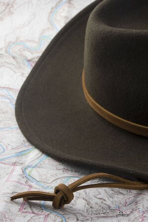 jones: wool felt western hat on a topography map background Stock Photo