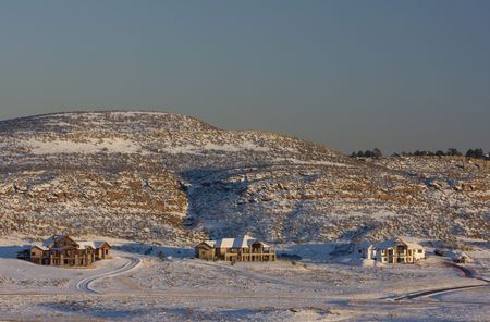 new upscale mountain houses under construction in Colorado Front Range area near Loveland, winter scenery photo