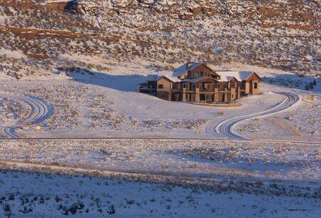 front range: new luxury house on mountainside in Colorado Front Range near Loveland in winter scenery