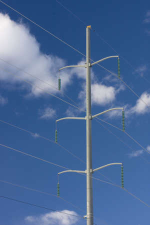 High voltage power line and pylon against blue sky and white clouds Stock Photo - 2283529