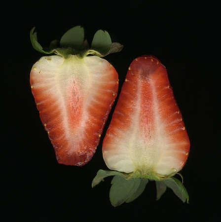 Strawberry cut in half on black background Stock Photo - 2344899