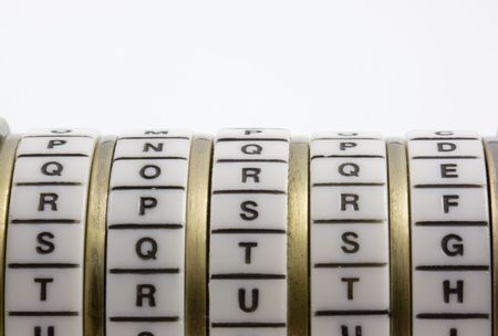 keyword: Password or keyword - truth. A combination puzzle box (cryptex) with letter rings on a white background; copy space. Stock Photo