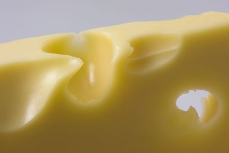 Closeup view of a delicious piece of cheese with holes Stock Photo - 2412392