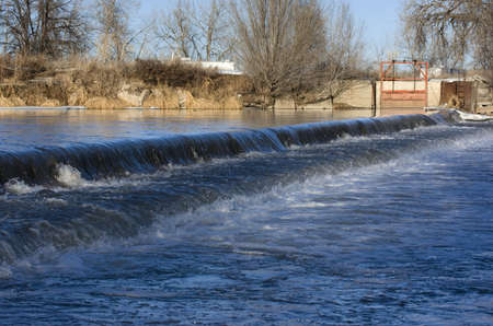 Low head dam diverting water for farmland irrigation - South Platte River in Colorado Stock Photo - 2457912