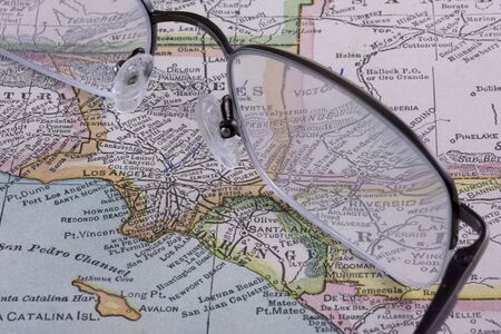 Los Angeles area on a vintage map (New International Atlas of the World, 1926 edition) with reading glasses photo