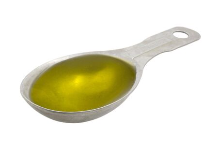 Measuring tablespoon of olive oil isolated on white,