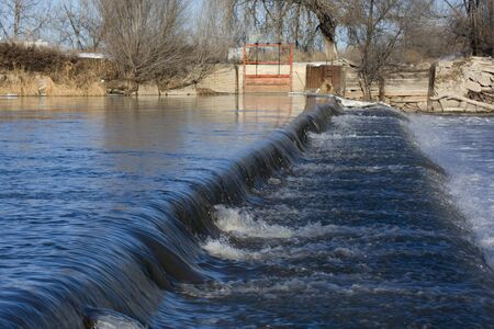 south platte river: a dam on South Platte River in Colorado near Greeley diverting water for farmland irrigation