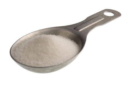 measuring spoon: old aluminum measuring spoon full of salt isoalted on white Stock Photo