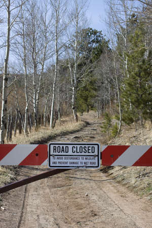 forest road closed to protect wildlife - white and red gate with a sign, Rocky Mountains, Colorado Imagens