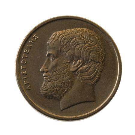 philosophy of logic: Aristotle, ancient Greek philosopher on a 5 drachmas coin (1990) isoilated on white Stock Photo