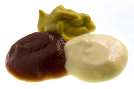 Blobs of tomato ketchup sauce, mayonnaise and mustard on white Stock Photo - 3053947
