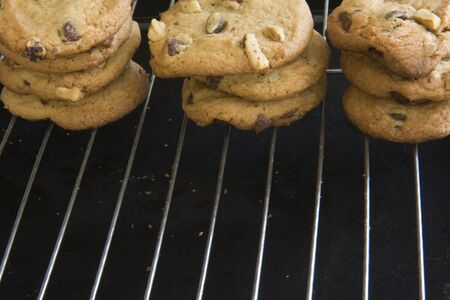 cooling racks and three stacks of cookies with chocolate chips and walnut, crumbs Stock Photo - 3096412