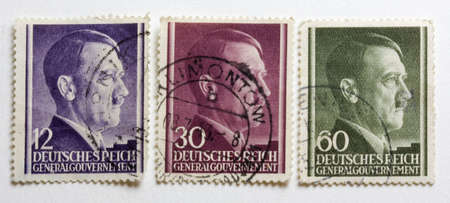 Adolf Hitler portrait on three German World War II post stamps issued and postmarked on the territory of occupied Poland (the General Government)