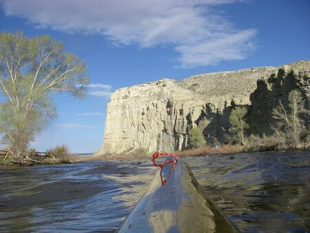 view from a bow of racing kayak on the North Platte River in Wyoming in springtime at high water Stock Photo - 3103234