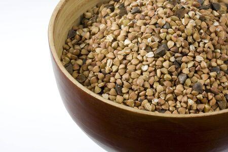 kasha: a wooden bowl of buckwheat (kasha), toasted whole grain, white copy space